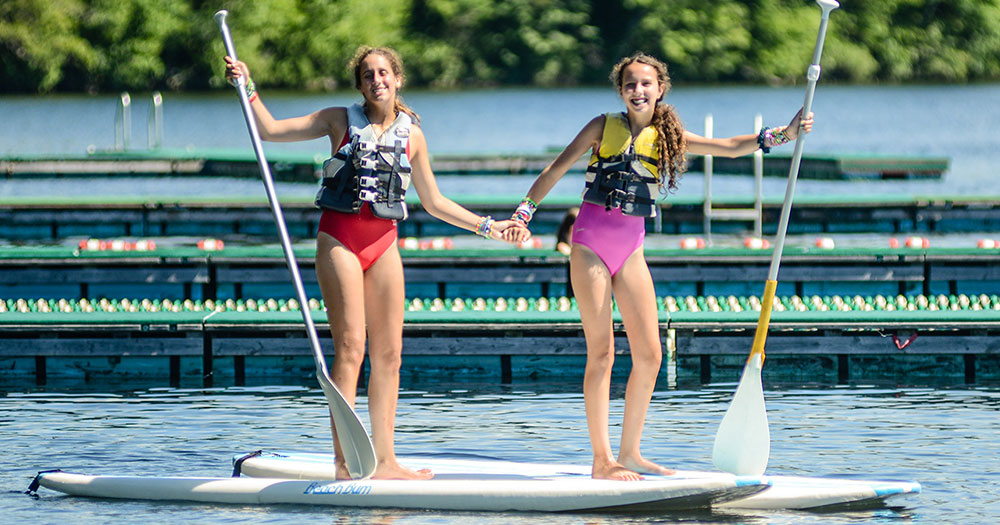 Stand up paddleboarding at Summer Camp
